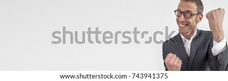expressive corporate man concept - joyful middle age businessman expressing energy and success with hand gesture,wide angle on long white banner background #743941375