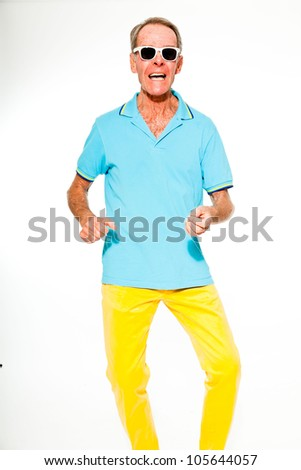 Expressive good looking senior man casual summer dressed against white wall. Wearing sunglasses. Happy, funny and characteristic. Isolated. Studio shot.