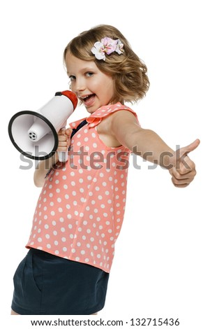 Expressive little girl with megaphone showing thumb up sign - stock photo