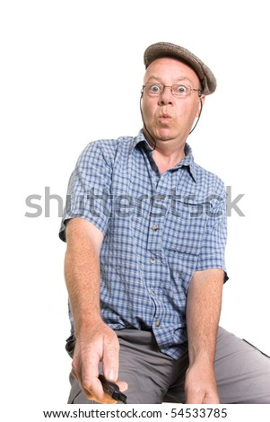 Expressive old man operating remote switch isolated against white background.