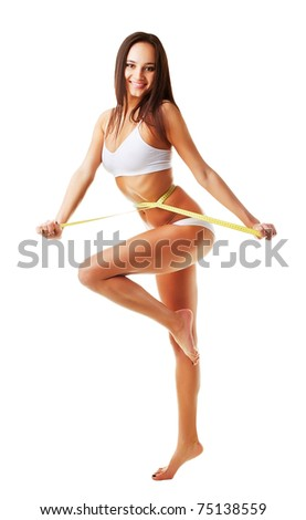 expressive sporty smiling woman with yellow measure on white background