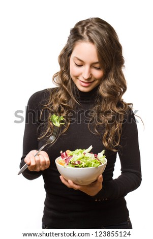 Expressive young brunette beauty with bowl of fresh salad.