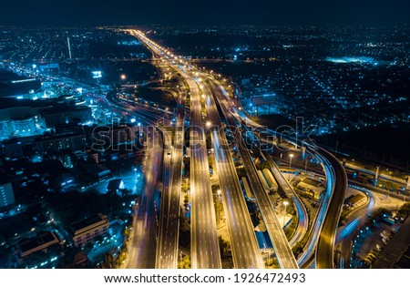 Expressway top view, Road traffic an important infrastructure in Thailand. Road and Roundabout, multilevel junction motorway, U turn road Stock photo ©