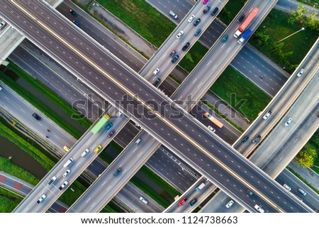 Expressway transport traffic road with vehicle movement logistic concept aerial view