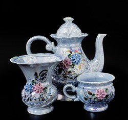 Exquisite Chinese set. Teapot, cups, vase. Teapot, cups, vase on a perfect black background.