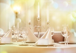 Exquisitely decorated wedding table with invitation cards