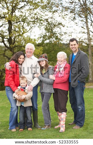 Extended Family Group On Walk Through Countryside
