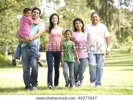 Extended Family Group Walking In Park