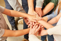 Extended family puts many hands on each other as a symbol of solidarity or network