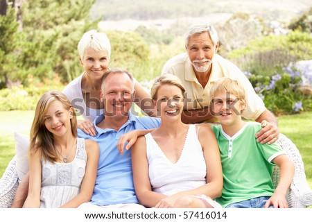 Extended Family Relaxing In Garden