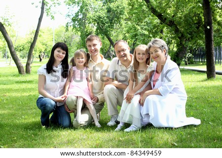 Extended family together in the summer park