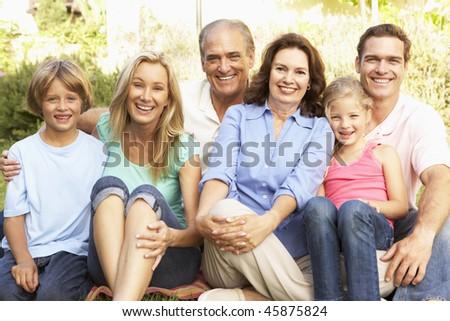 Extended Group Portrait Of Family In Garden