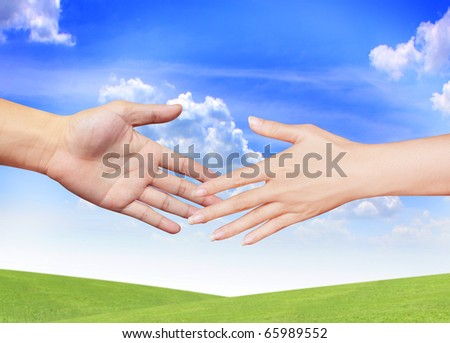 Extended hand for help on a sky