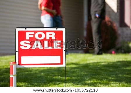 Extensive series of a Caucasian Real Estate Agent and African-American Couple in front of a home. #1055722118