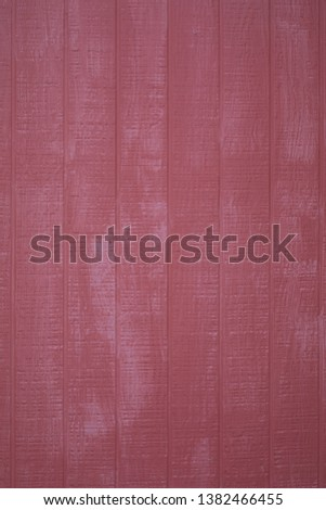 Exterion red barn wall, vertical planking, vertical format; #1382466455