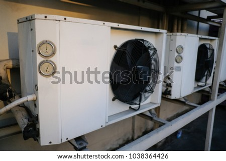 Exterior air conditioning unit on a wall ,Coil air heater.Hot air coil. #1038364426