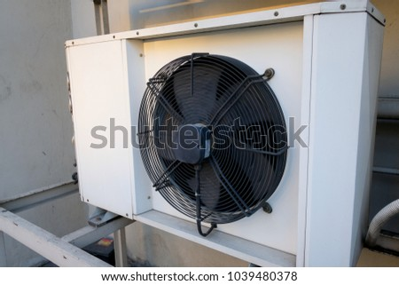 Exterior air conditioning unit on a wall ,Coil air heater.Hot air coil. #1039480378