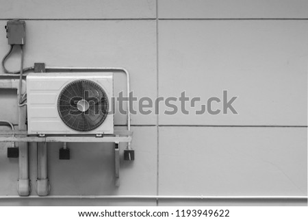 Exterior air conditioning unit on concrete wall ,Coil air heater.Hot air coil, image for Abstract texture and background #1193949622