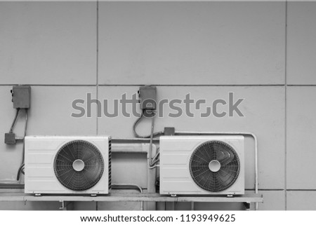Exterior air conditioning unit on concrete wall ,Coil air heater.Hot air coil, image for Abstract texture and background #1193949625