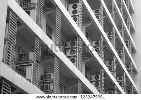 Exterior air conditioning unit on concrete wall ,Coil air heater.Hot air coil, image for Abstract texture and background #1232479981