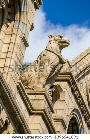 Exterior architectural detail of the Natural History Museum building in London United kingdom. natural history museum exhibits a vast range of specimens from various segments of natural history #1396541891