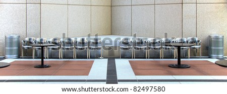 Exterior atrium of a modern office building to relax and eat lunch for workers and visitors - stock photo