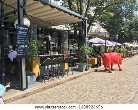 Exterior cafes on the street Deribasovskaya city of Odessa. Ukraine, Odessa, July 2018