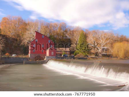 Exterior daytime long exposure stock photo of red barn structure on bank of Raritan river in Clinton, New Jersey in Hunderton County on semi-cloudy fall day
