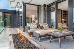 Exterior deck with large open gas fire
