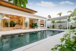 Exterior design of pool villa, house and home feature infinity swimming pool and garden