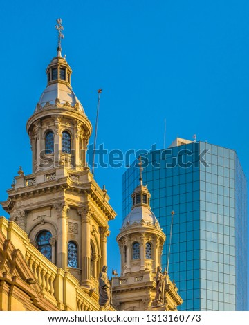 Exterior detail shot of famous metropolitan cathedral church and modern office tower building at background, santiago de chile city, chile #1313160773