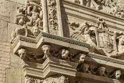 Exterior details of an architrave in Granada's Cathedral Ornamental figurines found in Granada's cathedral walls