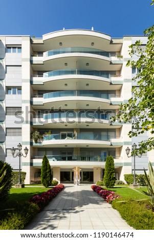 Exterior elegant modern condominium with garden, nobody inside