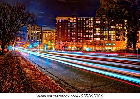 Exterior nighttime long exposure HDR stock photo of traffic along Lake Drive bordering Lake Calhoun in Uptown in Minneapolis, Minnesota