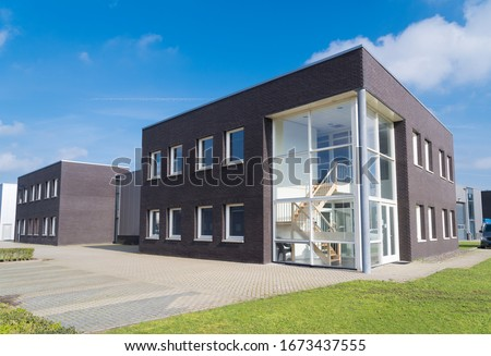 exterior of a modern office unit with a glass entrance Photo stock ©