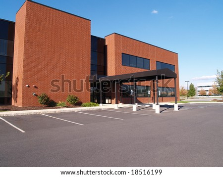 exterior of a red brick modern office building #18516199
