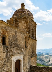 Exterior of an abandoned church in Craco, a ghost town in Basilicata region abandoned due to a landslide, Italy