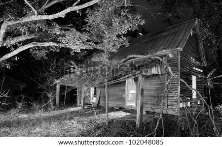 exterior of an old abandoned house at night