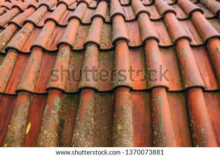 Exterior of brick house with red roof tiles, Prague. Retro red tile roof of old house #1370073881