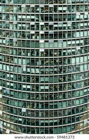 Exterior of glass windows on modern office skyscraper building