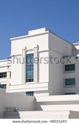 Exterior of hospital with tinted windows and blue sky