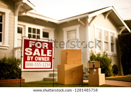 Exterior of house with for sale sign outside.