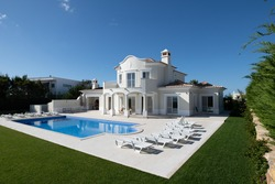 Exterior of luxury Holiday Villa with blue sky and beautiful swimming pool