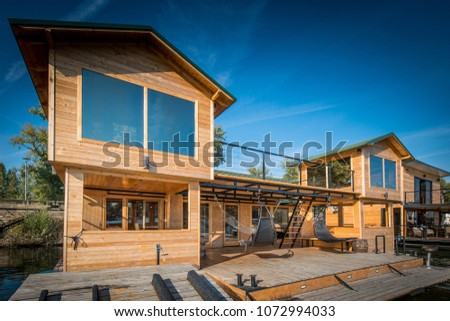 Exterior of luxury wooden cotagge next to river