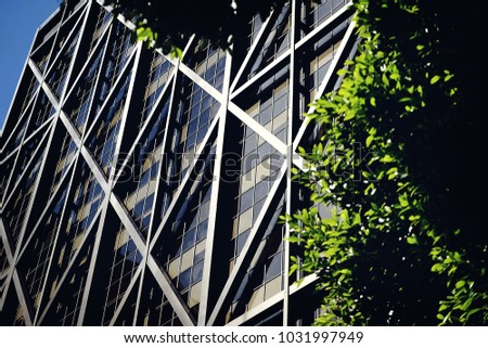Exterior of massive wire framed steel building #1031997949