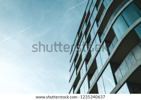 Exterior of modern business office building in London city skyline blue sky #1235340637