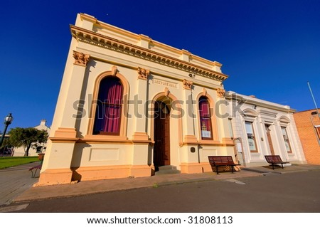 Exterior of old lecture hall and public library in a small town