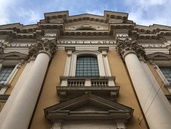 Exterior of the Basilica of Sant'Ambrogio e Carlo al Corso in Rome, Italy.  Looking up at the Facade of San Carlo al Corso Basilica in Rome. Close to the church, looking up.