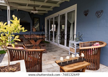 Exterior of the entertainment patio in the backyard of a contemporary suburban home