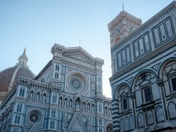 Exterior of The Florence Cathedral (Cattedrale di Santa Maria del Fiore), The Giotto's Campanile (Giotto's bell tower) and The Florence Baptistery (Baptistery of Saint John) in Tuscany, Italy